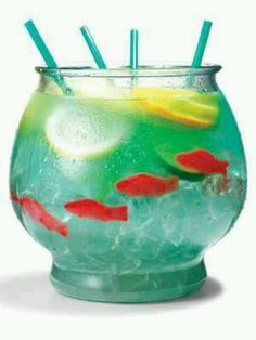 "This sounds banging. Can't wait to try it... Fish bowls! ½ cup Nerds candy ½ gallon goldfish bowl 5 oz. vodka 5 oz. Malibu rum 3 oz. blue Curacao 6 oz. sweet-and-sour mix 16 oz. pineapple juice 16 oz. Sprite 3 slices each: lemon, lime, orange 4 Swedish gummy fish Sprinkle Nerds on bottom of bowl as ""gravel."" Fill bowl with ice. Add remaining ingredients. Serve with 18-inch party straws."
