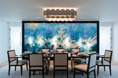 Gorgeous picture on the wall! It gives even more glamour to this dining room.