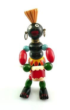 """HUGE vintage 1930s 40s hand carved and painted Bakelite articulated African Drummer design brooch pin. Measures 4-1/4"""" tall by 1-1/2"""" wide. Rare piece!"""
