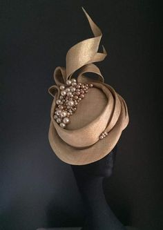 What a spectacular hat It's exceptional with all the dyed pearls and the stiff ribbons that really wrap the face.