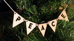 Ornament  Lasercut Peace Bunting by desTroy on Etsy, $15.00