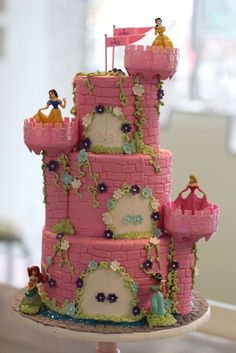 Princess Cake Ideas: pillars could be done with a stacking of cookies and then be iced over. I am going to attempt this for my daughter's birthday!