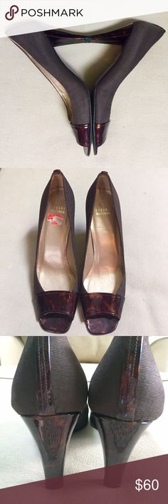 """Stuart Weitzman Heels, Euro size 40-1/2,US 10-1/2 Stuart Weitzman open toe heels, European size 40-1/2,US 10-1/2. Stuart Weitzman is known for gorgeous shoes and these certainly are! Rich brown faille fabric 3-1/2"""" heels are tipped at and under the toes with Tortoise patent. The back of the heel is accented with a vertical strip of Tortoise patent. Crafted in Spain and softly cushioned inside. Store price sticker inside shoe indicates $159 on sale. Excellent condition. Stuart Weitzman Shoes Stuart Weitzman, Inside Shoes, Price Sticker, Fashion Design, Fashion Tips, Fashion Trends, Tortoise, Open Toe, Euro"""