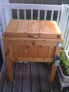 Patio/deck cooler stand: also has a bottle opener and a cap catcher! Wonder if there's a cut-out for the cooler's drain?