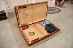 Hinged cornhole boards with latches -- easy way to store the bags, too!