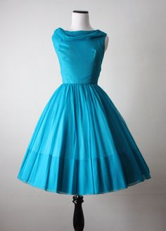 Stunning vintage 1950s bright blue chiffon cocktail dress with a full skirt, cinched waist, and a sash at the back. Gauzy chiffon layer over a silky