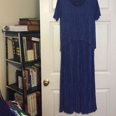 Blue micro-pleated dress. Elegant Navy blue dress, one piece. Micro-pleats give this dress an easy fit that shimmers when worn. Connected Dresses Midi