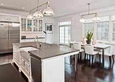 Love the stainless touches throughout this kitchen giving it a sleek, modern look.