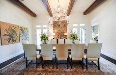 A feature of this dining room, this chandelier bring in an ethereal tone to this bright room.