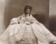 La Castiglione à l'éventail  by Pierre Louis Pierson.  Proust modeled one of his personnages in 'Remembrance of Things Past' on the  notorious Countess de Castiglione.who was also the mistress of Napoleon III.  She was known simiply as 'LaCastiglione'.