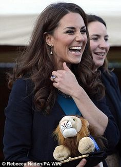 Kate certainly looked like she was having fun as she clutches onto her lion