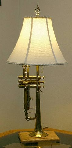 Trumpet lamp. I've been wanting to do this to one of our old trumpets for years! It's on my summer to-do list!