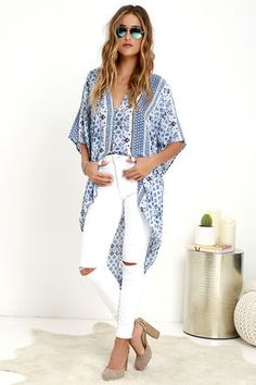 Find yourself mystified by moonlight as you dance under the night sky in the Ancient Magic Blue Print Tunic Top! A mesmerizing blue print decorates woven poly as it shapes a V-neckline and fluttering, wide-cut sleeves atop an oversized, button-up bodice. A high-low hem finishes off this breezy top.