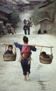 Love this photo. A mom giving up her comfort for her babies. She carries them now. One day, they will carry her.