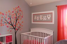 nursery with orange & pink.  like the gray walls, and the tree decal.