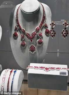 Ruby and diamond suite includes drop earrings and an elaborate necklace; note coordinating bracelet as well.   on display at Christie's Auction House until December 12, 2011; part of the Collection of Elizabeth Taylor exhibit.