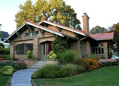 This classic California style Bungalow in London Ontario is one of the best in the country. Mission Style Homes, Spanish Style Homes, Spanish House, Front Porch Design, Garage Design, House Design, Art Deco Tiles, Craftsman Door, Ranch Exterior