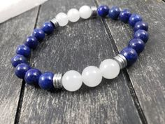 Unisex Dark Blue and White Gemstone Bracelet with Silver Accents, Lapis Lazuli and White Jade Stretch Bracelet with Silver Hematite Spacers by MayaMadeThis on Etsy Bar Earrings, Circle Earrings, Teardrop Earrings, Statement Earrings, Lapis Lazuli Bracelet, Lapis Lazuli Jewelry, Jade Jewelry, Jewelry Shop, Stretch Bracelets