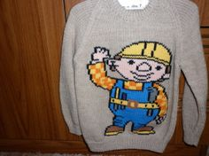 This sweater fits a 24 inch chest and has by Marionsknittedtoys, $33.00