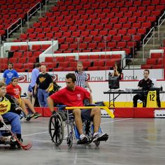 Noah of Carolina Fury Power Wheelchair League giving Canes' Shane Willis his best game face at PNC Arena. Manual Wheelchair, Powered Wheelchair, Game Face, Canes, Best Games, Hockey, Basketball Court, Lol, Sports
