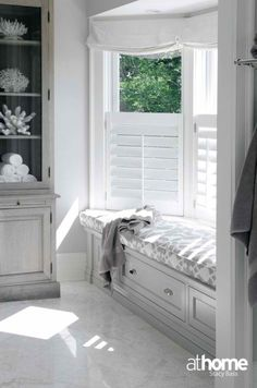 8 Excellent Bay Window Seat Examples for Your Recess Spot At Home in Fairfield County: Elegant gray master bathroom with bay windows and white roman shades. Gray built-in . Window Seat Curtains, Bay Window Shutters, Cafe Shutters, Window Frames, Blinds For Bay Windows, Bow Windows, Blinds Curtains, White Shutters, Roman Blinds