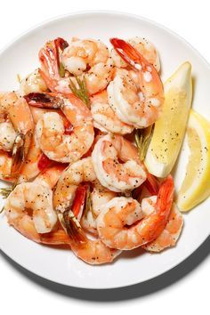 Shrimp is now the most popular seafood in America, and this bright and fragrant treatment couldn't be simpler. Just scatter several rosemary branches onto a sheet pan and top with shrimp. Drizzle with lemon juice and olive oil then roast until the shrimp are peachy pink all over. (Photo: Sam Kaplan for The New York Times)