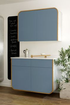 We love the sky blue colour of these floating units from deVOL's Air Kitchen Range.