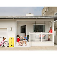 Berg breathed new life into the house by smartening up the masonry facade with contemporary bright white siding.