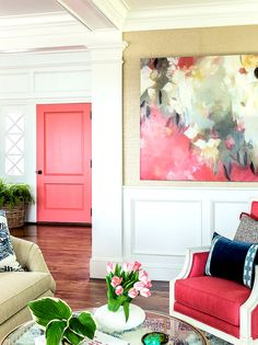 Pink door inside home and artwork to match