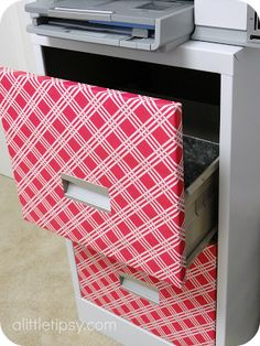 File Cabinet Makeover with wrapping paper-- an idea that probably won't get me in trouble because it isn't permanent! :)