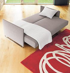 Something like this would be easier to maneuver to the 2nd floor.  Guest Room Decorating Ideas for a Dual-Purpose Space