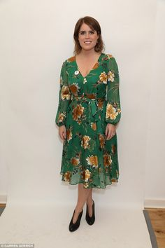 Stylish:The Queen's granddaughter showed off her curves in a vibrant green £460 Alice + Olivia floral print fil coupé chiffon dress adorned with yellow flowers