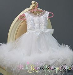 Sweet Flower Girl Dress with Crystal Bling   Dress bodice is Satin Rosette Fabric with High Quality Crystal trim around the neck line to the back, back is elasticated Skirt Part is Soft Chiffon lined in bridal satin fabric, with fluffy high quality feathers Double sided satin ribbon ties around the waist   Prefect for that special occasion   Sizes 1 - 5 years #timelesstreasure
