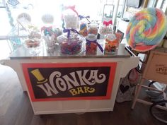 I love the candy bar, could put any sign on it... Sweet Shop, Taste the Rainbow, whatever went with theme.