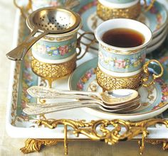Gold trimmed cups and serving tray