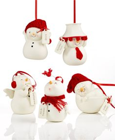 These are the cutest little snowmen ornaments I have ever seen.   Department 56 Snowpinions Ornament Collection - Holiday Lane - Macy's