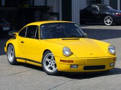 "46. RUF CTR ""Yellow Bird"" (1987)  This car, essentially a heavily modified Porsche 911, inspired many young car lovers when it appeared in the 1980s."