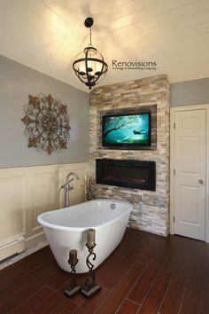 A Recently Completed Master Bathroom Remodel By Renovisions Bath Soaking Tub Free Standing Ledger Tile Wall Electric Fireplace Mounted