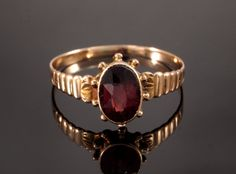 Antique Garnet Rose Gold Ring in 9k Gold by BelmontandBellamy