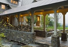 Open breezeway connecting garage & house with firewood storage. Loving the open concept.