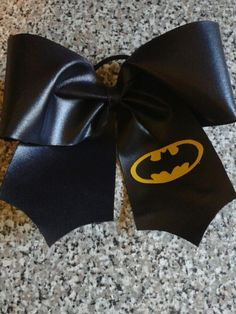 bc8302445addc Limited Edition Batman Bow by SizeMattersCheerBows on Etsy