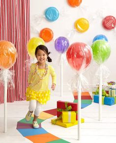 Turn colored plates and balloons turn into giant candy by wrapping them in clear cellophane.