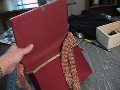 Hardcover book + handbag + belt