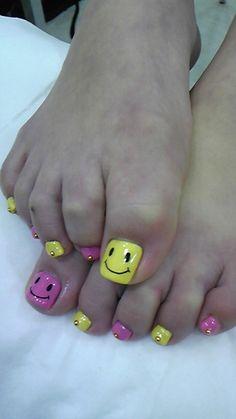 Happy face toe nails