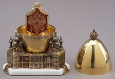 "(3) FABERGE egg__Theo Fabergé __ ""St. Petersburg "" Egg inspired by the homeland of his forefathers.The richness and intricate detail of this design reflect the opulence of the Imperial Court, the magnificent palaces and architectural style of this great city, St. Petersburg. A sterling silver egg surmounted by the Imperial Crown, enriched with 24 karat gold, resting on a snow white marble base."