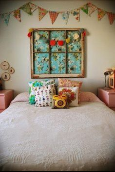 Old window idea!! Love the fabric and the Pom Pom banner