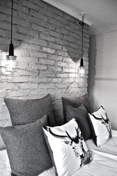 Gray brick wall and hanging pendants