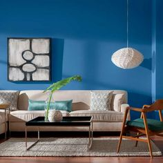 A daring wall color commands attention while neutral hues keep contemporary furnishings low-key. | Peek-A-Boo Blue, @valsparpaint Reserve