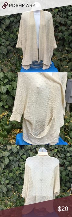 Urban Outfitters Knit Boho Cardigan Beautiful off-white oversized cardigan with side pockets and cuffs on 3/4 sleeves (see 2nd photo). Light-weight material perfect for summer nights and fall weather. Staring at Stars Sweaters Cardigans