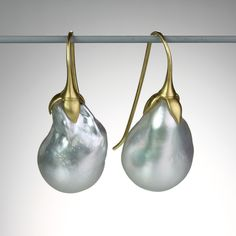 This pair of Gabriella Kiss earrings feature gorgeous eggplant shaped South Sea pearls, topped with handmade 18k yellow gold ear wires. The one of a kind earrings are eye-catching treasures with high luster and an unusual shape. @QUADRUM